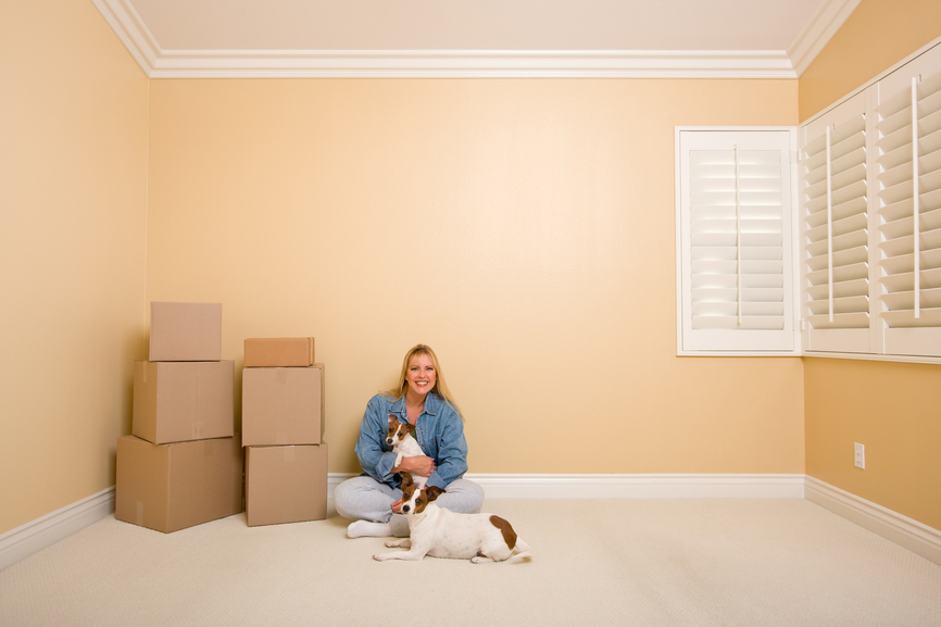 woman with dog moving