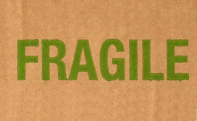 Fragile written on corrugated cardboard packet